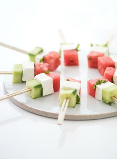 Save this healthy summer mini appetizer skewer recipe to make Feta, Watermelon + Cucumber Cubes for your pool + beach parties.