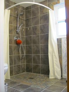 no curb or ridge or floppy membrane is necessary in a good curbless shower