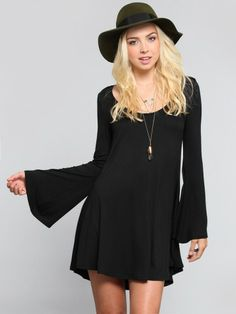 7b77af7f3e Super soft jersey dress featuring long bell sleeves and a flowy silhouette  that flares slightly away