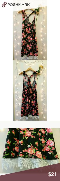 Floral Tank Top Dress This has roses on a black backdrop. The end is white lace with a cinched back. Perfect for layering. Dresses