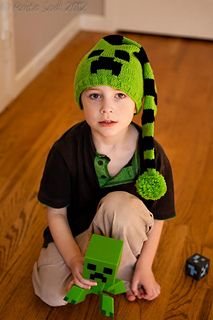 """This pattern is a bright green and black stocking cap based on the Minecraft Creeper. It is knitted in the round, but for the intarsia section it is worked back and forth. It was knit with spring green and black yarns, from the base up. Right now the PDF of the intarsia pattern is linked here, and the written directions for the pattern are on my blog (linked above """"for more information"""") Working on fixing them up so that they are together…"""