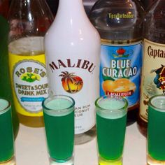 LIQUID MARIJUANA (does not contain real marijuana) ~ 1 part Captain Morgan, 1 part Coconut Rum, 1 part Midori, 1 part Blue Curacao, Splash of Sweet & Sour, Splash of Pineapple Juice