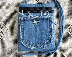 Check out our upcycled denim purse selection for the very best in unique or custom, handmade pieces from our shoulder bags shops. Denim Backpack, Denim Purse, Jean Purses, Purses And Bags, Recycle Old Clothes, Denim Handbags, Patterned Jeans, Denim Crafts, Recycled Denim