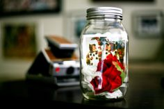 Lighted Mason Jar featuring a Polaroid of Wonderlands Painting the White Roses Red (batteries included)