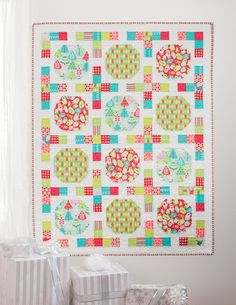 Big Snowball blocks are a great way to showcase fun Christmas prints--plus, this easy pattern is perfect for large-scale prints of all kinds. From the book Simply Modern Christmas by Cindy Lammon.