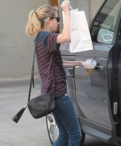 Emma Roberts was recently spotted carrying a black Gucci Soho Disco Bag while getting takeout from popular LA eatery Joan's on Third.