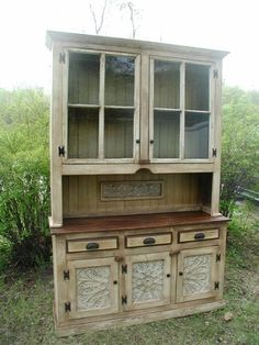 Reclaimed furniture. Love the inserts in the doors on the bottom.