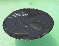 Warm pool. Black garbage bags over hoola hoopa throw in water.