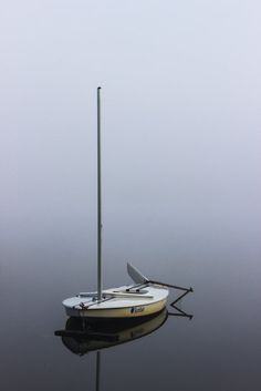 Sunfish in the Fog by Marra Clay on Capture Minnesota // Sunfish sailboat on a foggy morning at the cabin.