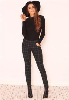 """We're going gaga over printed anything this season! These fe,enine grunge tartan trousers feature a grid print design with a flattering tapered leg and high waisted fit. They're the perfect pair to take you from day to night in an instant. Team with a crop top and biker jacket for a no fuss with serious style power outfit. Approx length 97cm/37.4"""" (Based on a UK size 8 sample) Model wears a UK size 8 and her height is 5ft 7"""""""