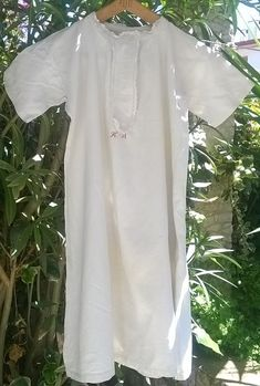 www.sophieladydeparis.etsy.com Antique homespun white #hemp dress lace trimmed round the neck. Handmade French country side gown 1850's made. Thick hemp made. Victorian Dres... #antiquelinens #victorianclothing #sophieladydeparis #vintageclothing #antiquebabyclothing