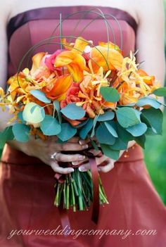 Orange and teal wedding bouquet - what are these teal leaves?