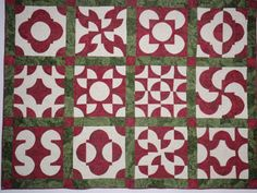 Red and green drunkard's path quilt.