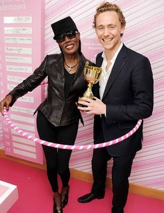 What? Of course Tom Hiddleston is in a hula hoop with Grace Jones.