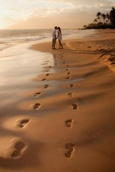 footprints in the sand, could be the whole family... your child or that speical someone :)