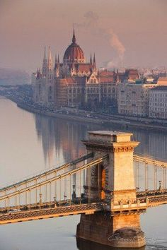Sunrise over the Szechenyi Chain Bridge and Hungarian Parliament Building beside the river Danube in Budapest, Hungary---- One of the most under-rated cities in the world. so beautiful, visiting budapest is on my bucket list! Places Around The World, Oh The Places You'll Go, Travel Around The World, Places To Travel, Places To Visit, Around The Worlds, Travel Things, Travel Stuff, Travel Destinations