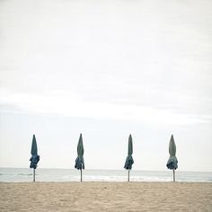 by Salva Lopez, umbreals on the beach, photograph