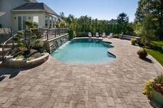 in ground pool featuring a vinyl liner hardscape fencing concrete patio and deck jets. Black Bedroom Furniture Sets. Home Design Ideas