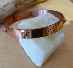 wide rose bangle clad in rose gold plate by veiledjewelry on Etsy, $40.00