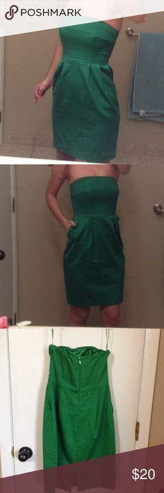 Express strapless green dress Great holiday green dress, strapless with pockets, slit at back. It is a size 0, i wore this cute dress once with leopard heels. Express Dresses Strapless