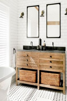 I love this collection of farmhouse bathrooms. The subway tile is beautiful and look at that floor. These bathrooms are stunning. The perfect touch of farmhouse and rustic. #neutralhome #neutralbathroom #subwaytile #subwaytilebathroom #fixerupperstyle #fixerupper #joannagainesinspired #joannagaines #rusticbathroom #farmhousebathroom #afflink #rustichome