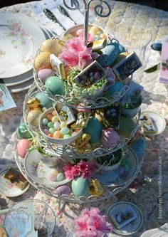 A three-tiered server/cupcake stand provides a quick & easy Easter centerpiece for the table and dessert too!  homeiswheretheboatis.net #Easter #table