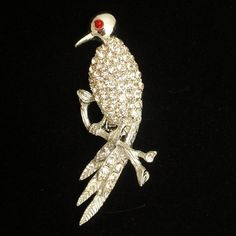 Figural bird pin in silver tone metal with rhinestones. The pin is in good to very good condition. This bird pin measures 2 x 1 Bird Jewelry, Unique Jewelry, Brooch, Trending Outfits, Handmade Gifts, Vintage, Etsy, Kid Craft Gifts, Brooches