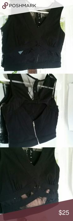 Sexy black crop top Mesh & a zipper & eye hooks. This crop is to die for. Tag says medium,  but it's really a small raver punk fasionista must Body Central Tops Crop Tops