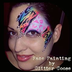 Neon rainbow animal print eye design by Glitter Goose! Tiger Cheetah Leopard paint cool colorful fun lisa frank style teen adult mask face painting.