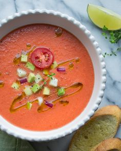Gazpacho - a cold soup, Spanish in origin, usually made from finely chopped cucumber, tomato, onion and red pepper, seasoned with olive oil and garlic. The mystery of how gazpacho made its way from Spain to the American South still remains unsolved. - J.L. Rolland / Carol Sherman