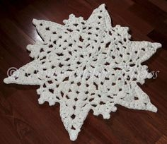 Ravelry: Ice Mountain Snowflake Rug pattern by Deborah Atkinson. Wonder if I could some how modify this to make it open for a tree skirt? Crochet Snowflake Pattern, Crochet Rug Patterns, Crochet Snowflakes, Crochet Mandala, Crochet Motif, Crochet Yarn, Free Crochet, Mandala Rug, Thread Crochet