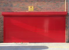 RSG5100 Commercial Security Roller Shutter fitted externally to the main entrance of a recognised nationwide distribution centre, DHL, in Wembley.