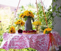 "A colorful ""swing table"" is perfect for outdoor entertaining! This quick and simple DIY project can be attached to trees or gazebos, or under porches. A great conversation piece!"