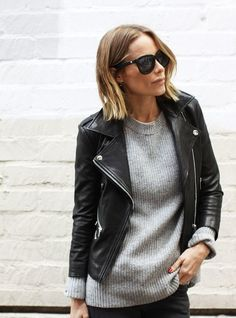 To create an outfit for lunch with friends at the weekend reach for a black leather biker jacket and black jeans.   Shop this look on Lookastic: https://lookastic.com/women/looks/black-leather-biker-jacket-grey-crew-neck-sweater-black-jeans/18189   — Grey Crew-neck Sweater  — Black Leather Biker Jacket  — Black Jeans