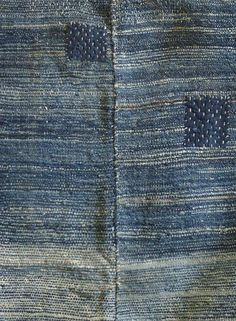 asagi (pale blue) cotton sleeves which are densely sashiko stitched and so worn that the stitches seem embedded in the fibers of the cloth.