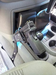 Gun stand with Blackhawk holster I made for my 06 Dodge truck. The gun is a XD 45.
