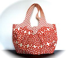 Holds Everything bag by knitshearbliss on Etsy. I NEED a bag like this to carry my crochet and other crafty projects around in.  The lining has many many pockets, and adding an elasticized pocket on the outside edge (like for a water bottle) might work well.  The fabric covered button closure is adorable!