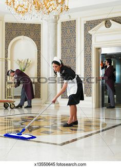 Stock Image of Maid mopping hotel foyer, male staff cleaning in background - Search Stock Photos, Mural Pictures, Photographs, and Photo Clipart - Hotel Foyer, Photo Clipart, Cleaning Maid, Hotels And Resorts, Luxury Hotels, Still Image, Royalty Free Images, Stock Photos, Portrait