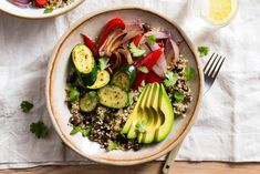 Black bean and quinoa burrito bowls with mixed vegetables and avocado