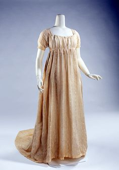 Dress, 1800–1805, American. The Empire silhouette is readily identified with its origin in the chiton of ancient Greco-Romans, a tubular garment draped from the shoulders and sometimes belted beneath the bust. Several re-interpretations have been made throughout costume history but none as notable as the period bridging the rectangular panierred skirts of the 18th century and the conical hoop skirts of the 19th century.