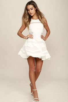 Sweet, playful, and totally charming, the Play Nice Ivory Skater Dress will earn you admirers left and right! Ivory woven poly is silky soft and light throughout the fitted bodice with rounded neckline, princess seams, and sexy sheer mesh panels. The skater skirt completes this party-ready ensemble with more alluring bands of mesh. Circular cutout at back. Hidden side zipper with clasp.