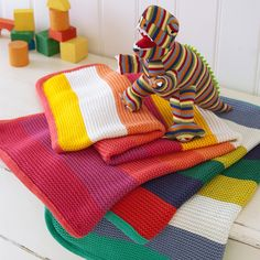 Knitted stripey baby blanket