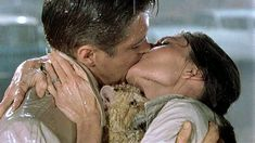 Holly Golightly and Paul Varjak - Breakfast at Tiffany's, 1961. End kiss in the rain, after Holly has found Cat.