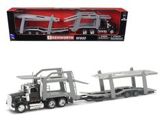 Kenworth W900 Black with twin Auto Carrier 1/43 by New Ray - Brand new 1:43 scale model of Kenworth W900 Black with twin Auto Carrier by New Ray. Wheels roll. Detailed interior, exterior. Cabin is diecast metal, the rest is plastic parts. Dimensions approximately L-16.5, W-2.5, H-4 inches. Please note that manufacturer may change packing box at anytime. Product will stay exactly the same.-Weight: 3. Height: 10. Width: 16. Box Weight: 3. Box Width: 16. Box Height: 10. Box Depth: 8