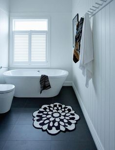 A damp and musty bungalow has been given a new lease of life and is loved once more thanks to its new owners In a nutshell Who lives here? Eva Nash (director of Rogan Nash Architects), David Nash (Bunnings national supply chain manager), Nico, Asi Bungalow Bathroom, Bathroom Renos, Laundry In Bathroom, Simple Bathroom, Bathroom Renovations, Modern Bathroom, Rental Bathroom, Bunnings Bathroom, Colorful Bathroom