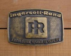 Check out Vintage 1976 Ingersoll-Rand Brass Belt Buckle A Worldwide Symbol Of Quality, patina, industrial, transportation, locomotive tools drill oden on vintagecornerbazaar
