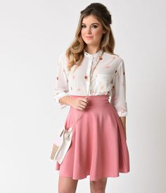 Just one more scoop, darling. Say hello to a pristinely constructed blouse in an adorable ice cream print! Complete in stunning flavors of chocolate, strawberry, and vanilla set against soft ivory, this flowing long sleeve chiffon top has a becoming bande