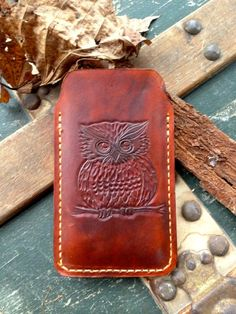 This iPhone case is 100% handmade. It was hand-cut, hand-shaped, hand-sewn, hand-carved and hand-finished from Top Grade Vegetable Tanned Leather. It is also pre-shaped to fit an iPhone 4 or 4s. However, this case can also be made and shaped for an iPhone 5! $35.00 on http://www.etsy.com/shop/TheCabinGiftShop