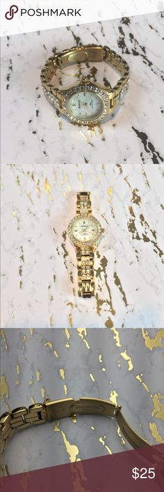 Armitron Gold Watch Armitron gold watch with crystals. Beautiful piece, never worn :)  Will need new battery Armitron Accessories Watches