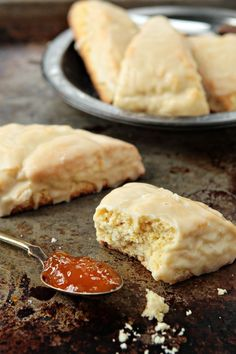 Tender scones infused with orange zest and finished with a sweet orange glaze.